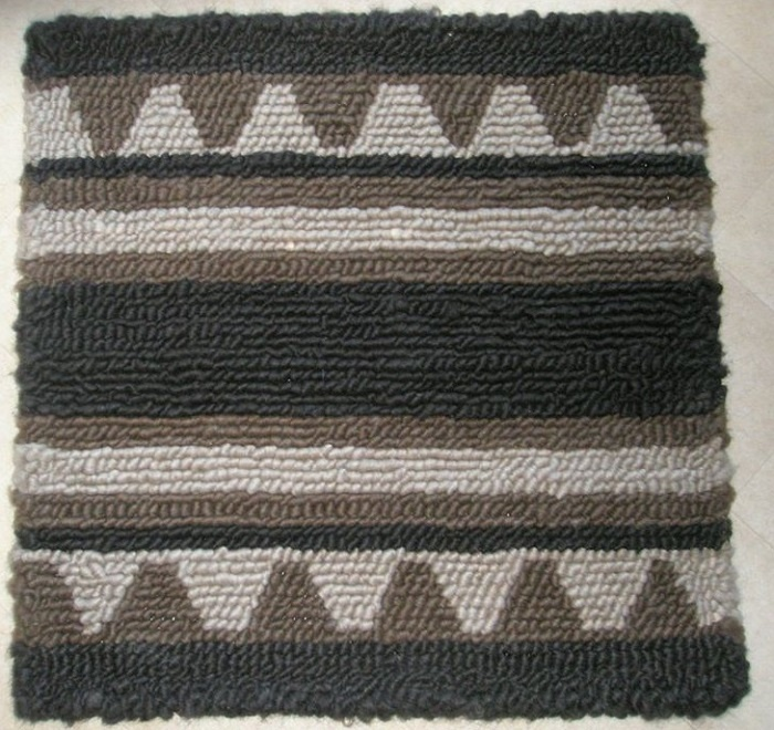 hand made wool saddle pad with stripes and triangles