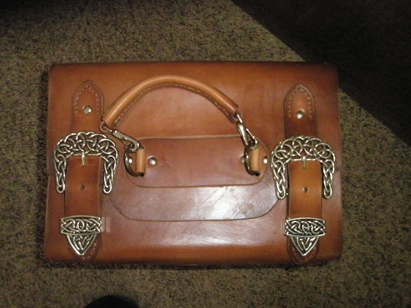 top view of leather case with handle and buckles